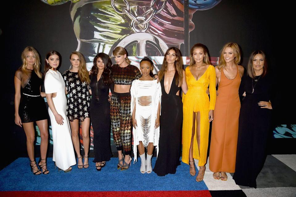 """<p>Taylor Swift rolled up to the 2015 VMAs red carpet with her whole squad from her """"Bad Blood"""" video, which she released that night.</p>"""
