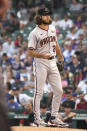 Arizona Diamondbacks starting pitcher Zac Gallen tosses the ball during the first inning of a baseball game against the Chicago Cubs in Chicago, Friday, July 23, 2021. (AP Photo/Nam Y. Huh)