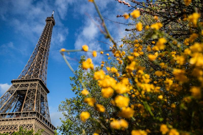 An estimated 150,000 people visit the grounds around the Eiffel Tower each day in the high season, including 20,000 to 30,000 who actually climb the monument