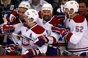 From left, Scott Gomez, Brian Gionta, Glen Metropolit and Mathieu Darche celebrate as time runs out on the Penguins