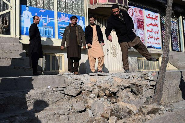 PHOTO: Residents gather at a site after several rockets land at Khair Khana, north west of Kabul on November 21, 2020.  (Wakil Kohsar/AFP via Getty Images)