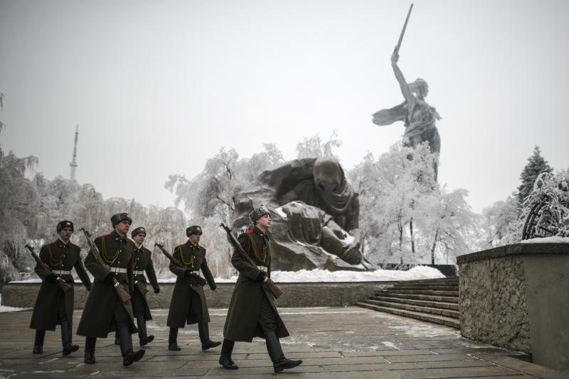 Members of the Honour Guard walk near the Motherland Calls statue in Volgograd