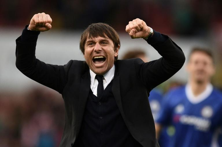 Chelsea's manager Antonio Conte celebrates after winning their English Premier League match against Stoke City, at the Bet365 Stadium in Stoke-on-Trent, on March 18, 2017