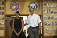 <p>Presumably post opening presents and spending time with their family, Michelle and Barack Obama paid a visit to Marine Corps Base Hawaii in Kaneohe Bay, Hawaii, to thank members of the military for their service. While the President dressed down in a white short-sleeved button down, the first lady was all dressed up in a perfect black sun dress with crochet detailing. </p>