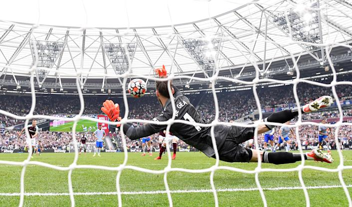 Man United goalkeeper David de Gea saves a last-minute penalty by West Ham's Mark Noble during their Premier League match at London Stadium