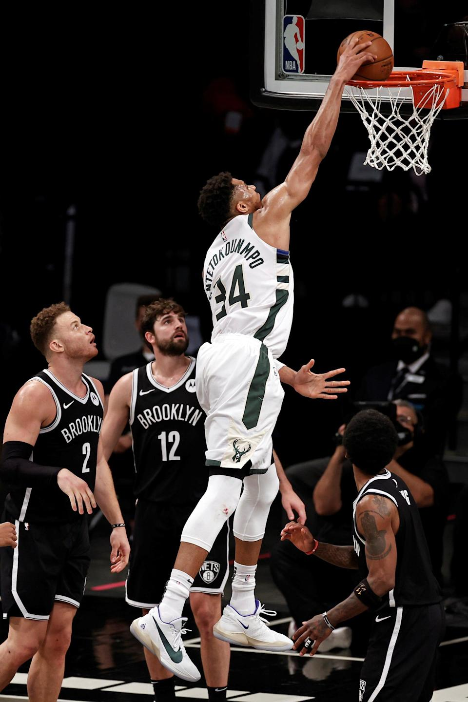 Milwaukee Bucks forward Giannis Antetokounmpo (34) dunks the ball over Brooklyn Nets forward Joe Harris (12) during the second half of Game 1 of an NBA basketball second-round playoff series Saturday, June 5, 2021, in New York. (AP Photo/Adam Hunger) ORG XMIT: NYOTK