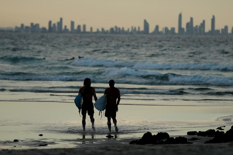 People on the beach at Snapper Rocks which is on the Queensland and New South Wales border at Coolangatta.