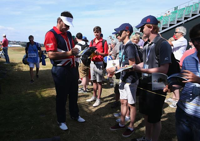 GULLANE, SCOTLAND - JULY 17: Sir Nick Faldo of England signs autographs ahead of the 142nd Open Championship at Muirfield on July 17, 2013 in Gullane, Scotland. (Photo by Andy Lyons/Getty Images)