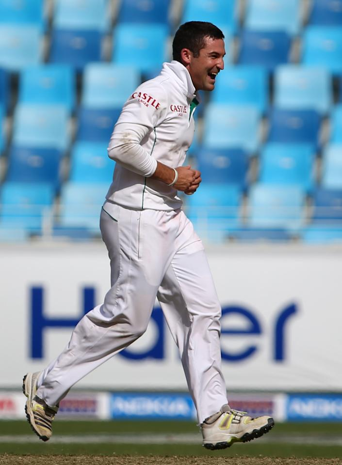 Bowler Dean Elgar of South Africa celebrates after taking the wicket of Pakistan's captain during the fourth day of the second Test cricket match between Pakistan and South Africa in Dubai on October 26, 2013. AFP PHOTO/MARWAN NAAMANI        (Photo credit should read MARWAN NAAMANI/AFP/Getty Images)