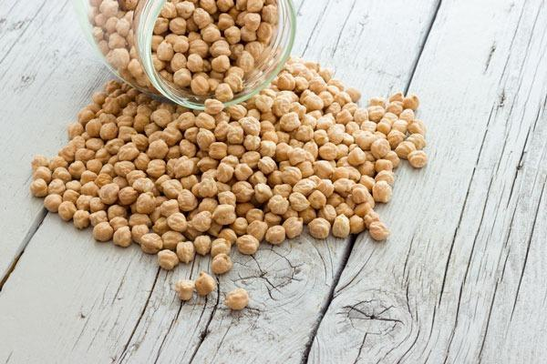 """The fiber-filled chickpea requires almost 609 gallons of water to produce just eight ounces of the legume. Because chickpeas require residual soil moisture to grow properly, increasing changes in climate and a rise in droughts pose a major threat to our beloved hummus staple. In fact, thanks to terminal droughts that shorten the growing season, there has been a <a rel=""""nofollow noopener"""" href=""""https://www.ncbi.nlm.nih.gov/pmc/articles/PMC4011848/#pone.0096758-Ahmad1"""" target=""""_blank"""" data-ylk=""""slk:40 to 50 percent"""" class=""""link rapid-noclick-resp"""">40 to 50 percent</a> reduction in chickpea yield worldwide. Other factors include rising temperatures, which also adversely affects pollen viability, fertilization, and seed development."""