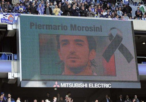 People observe a moment of silence for Italian footballer Piermario Morosini
