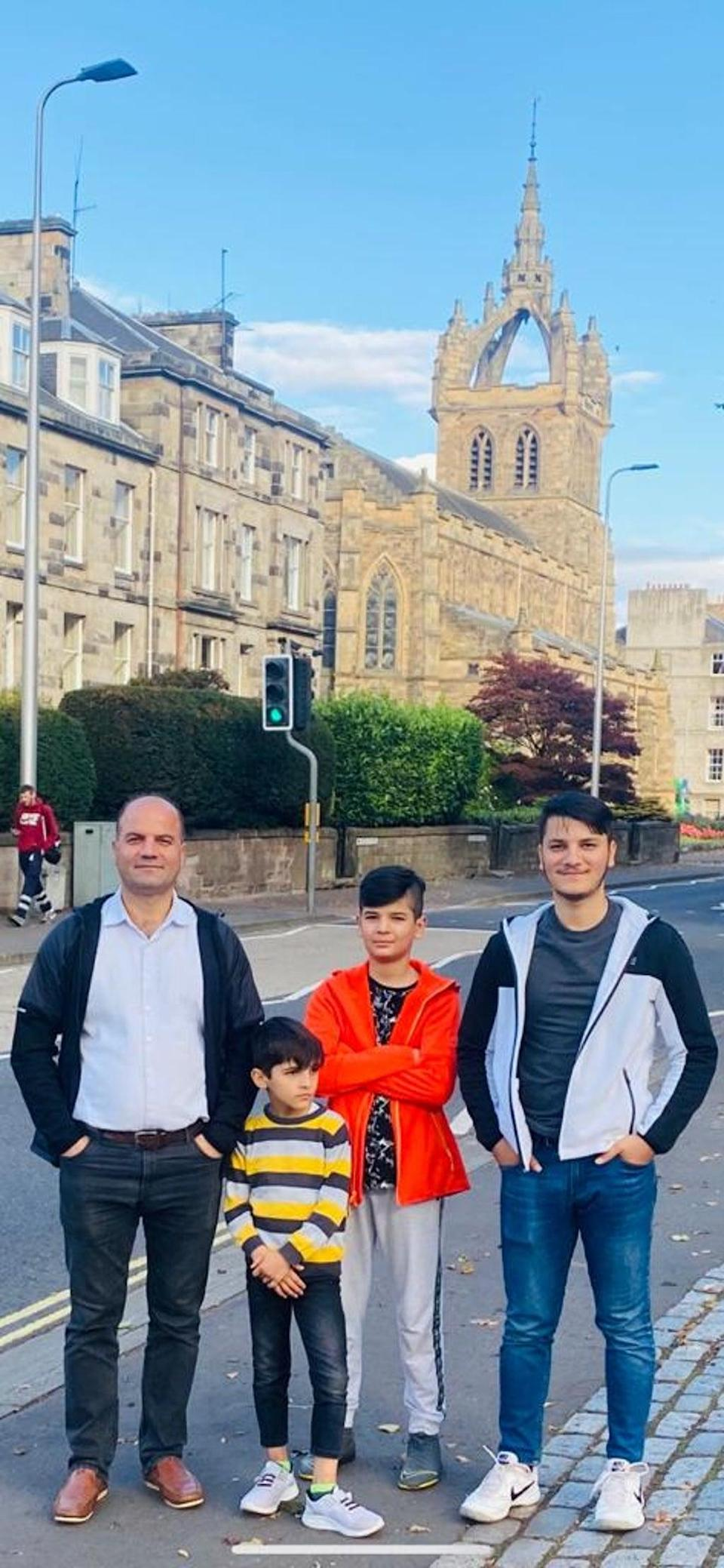 Sayed and his sons in their new home in Perth, Scotland (Sayed Hashemi)