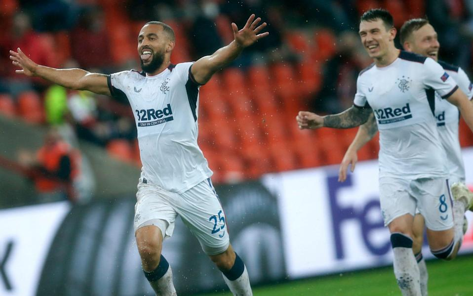 Rangers' Kemar Roofe, left, jubilates with teammates after scoring his sides second goal during a Europa League Group D  - AP