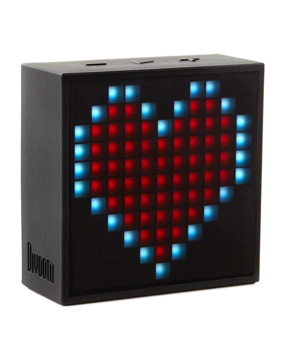 """<p>Switch out an ordinary alarm clock for this <a href=""""https://www.popsugar.com/buy/Divoom-Timebox-Mini-499009?p_name=Divoom%20Timebox%20Mini&retailer=amazon.com&pid=499009&price=38&evar1=geek%3Aus&evar9=36141091&evar98=https%3A%2F%2Fwww.popsugar.com%2Fnews%2Fphoto-gallery%2F36141091%2Fimage%2F44336883%2FDivoom-Timebox-Mini&list1=family%2Cneiman%20marcus%2Cgadgets%2Choliday%2Cchristmas%2Cgeek%20gear%2Cgift%20guide%2Cproducts%20under%20%24100%2Choliday%20living%2Ctech%20gifts%2Choliday%20tech%2Cgifts%20under%20%2450%2Cunder%20%24100&prop13=api&pdata=1"""" class=""""link rapid-noclick-resp"""" rel=""""nofollow noopener"""" target=""""_blank"""" data-ylk=""""slk:Divoom Timebox Mini"""">Divoom Timebox Mini</a> ($38). It has all sorts of useful functions and you can change the images that show up on the screen.</p>"""