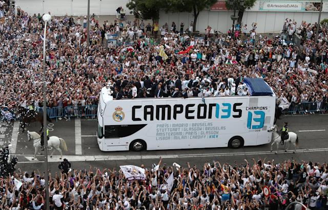 Soccer Football - Real Madrid celebrate winning the Champions League Final - Madrid, Spain - May 27, 2018 Real Madrid players and fans celebrate during victory celebrations REUTERS/Sergio Perez