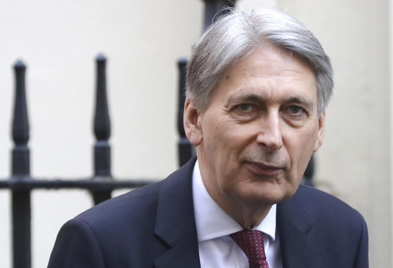 "FILE - In this file photo dated Wednesday, April 10, 2019, Britain's Chancellor of the Exchequer Philip Hammond in Downing Street in London.  Hammond, who stepped down as Treasury chief before Boris Johnson became prime minister, has broken his silence on the new administration in an article published in The Times of London Wednesday Aug. 14, 2019, saying Britain is being pushed towards a no-deal Brexit by ""unelected people"".  (AP Photo/Kirsty Wigglesworth, FILE)"