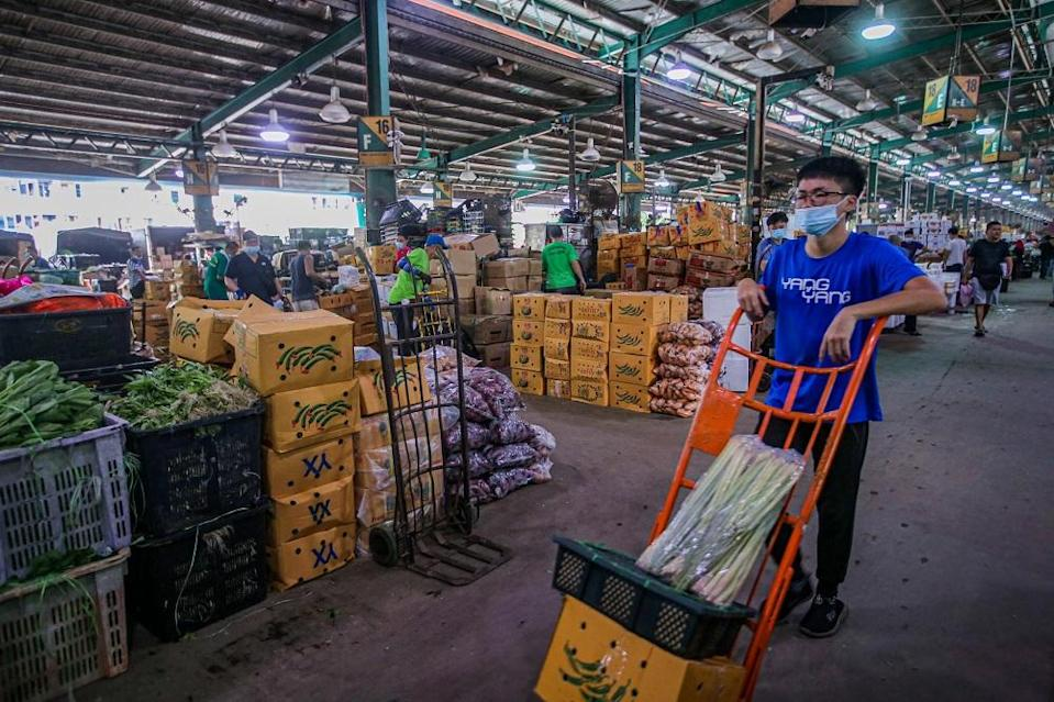 The new uniforms will be made compulsory for license holders and workers at the Kuala Lumpur wholesale market. ― Picture by Hari Anggara
