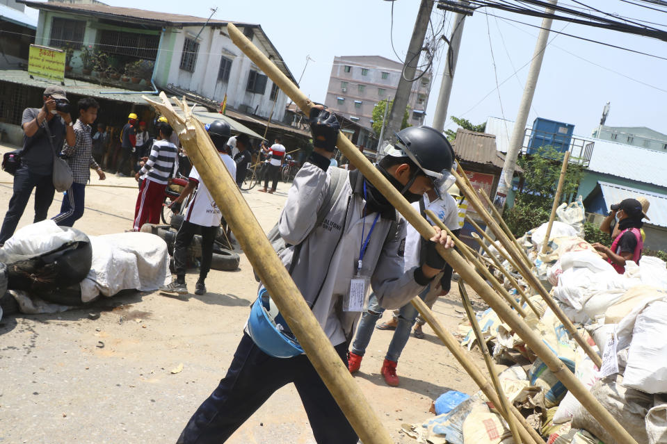 Protesters prepare to defend themselves as they gather in Tarkata township, Yangon, Myanmar Saturday, March 20, 20201. Protests against last month's military takeover continued Saturday in cities and town across Myanmar despite a crackdown by security forces that has taken more than 200 lives. (AP Photo)