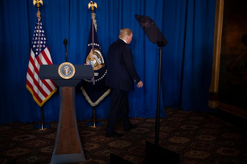 President Trump walks off after delivering remarks on Iran at his Mar-a-Lago property in Palm Beach, Fla., on Jan. 3, 2020. | Evan Vucci—AP
