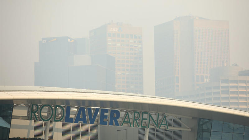 Rod Laver Arena with Melbourne city shrouded in smoke.
