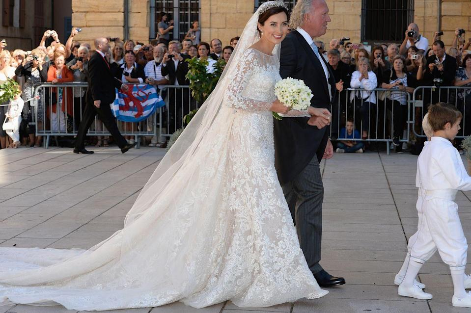 "<p>Princess Claire wore a long-sleeve Elie Saab gown covered entirely in lace for her marriage to <span class=""redactor-unlink"">Prince Félix.</span></p>"