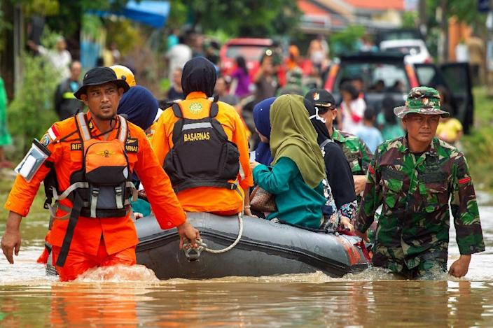 Thousands have been forced to flee their homes after their communities were inundated by floodwaters (AFP Photo/YUSUF WAHIL)