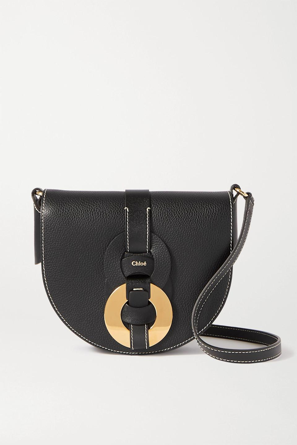 """<p><strong>Chloé</strong></p><p>net-a-porter.com</p><p><strong>$1250.00</strong></p><p><a href=""""https://click.linksynergy.com/deeplink?id=6Km1lFswsiY&mid=24449&murl=https%3A%2F%2Fwww.net-a-porter.com%2Fen-us%2Fshop%2Fproduct%2Fchloe%2Fdarryl-small-textured-leather-shoulder-bag%2F1298127"""" rel=""""nofollow noopener"""" target=""""_blank"""" data-ylk=""""slk:Shop Now"""" class=""""link rapid-noclick-resp"""">Shop Now</a></p><p>This bag feels like the new kid in town who everyone wants to be seen with. It simply upgrades the iconic details that make Chloé iconic, like contrast stitching, geometric shapes, and equestrian-inspired silhouettes.</p>"""