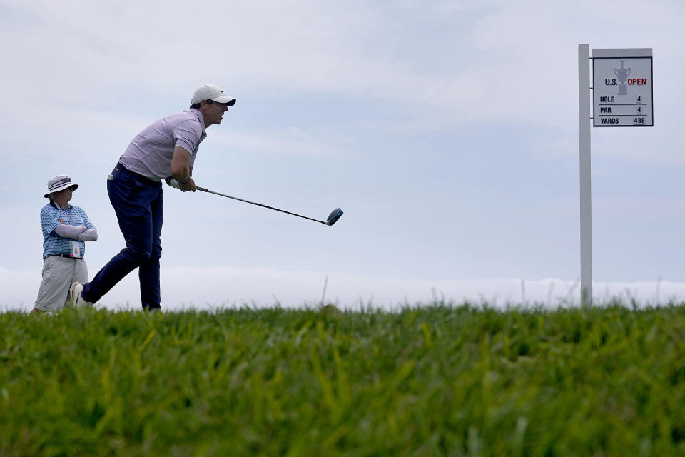 Rory McIlroy, of Northern Ireland, watches his shot from the 14th tee during a practice round of the U.S. Open Golf Championship, Wednesday, June 16, 2021, at Torrey Pines Golf Course in San Diego. (AP Photo/Marcio Jose Sanchez)