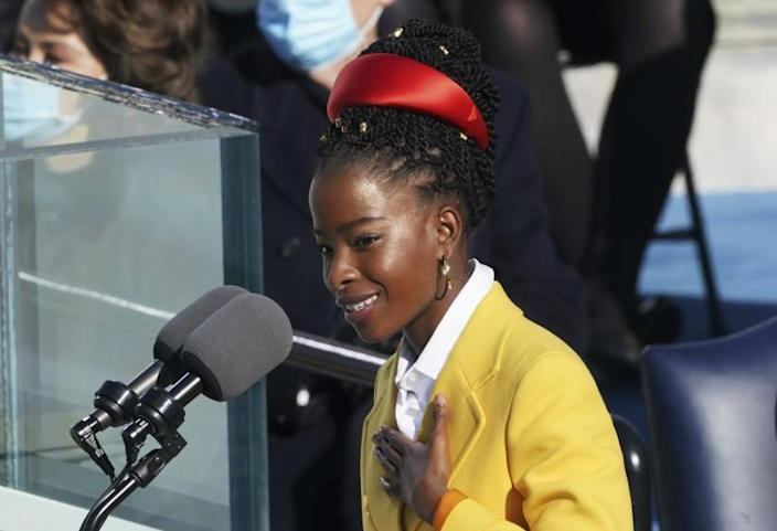 FILE - In this Wednesday, Jan. 20, 2021, file photo, Amanda Gorman delivers a poem after Joe Biden was sworn in as the 46th president of the United States, at the U.S. Capitol in Washington. Gorman, the 22-year-old poet who stirred America at the inauguration of President Joseph Biden, again commanded the spotlight on one of the country's biggest stages, the Super Bowl. Gorman read an original poem Sunday, Feb. 7, 2021, during the pregame festivities in Tampa, Fla. (Erin Schaff/The New York Times via AP, Pool, File)
