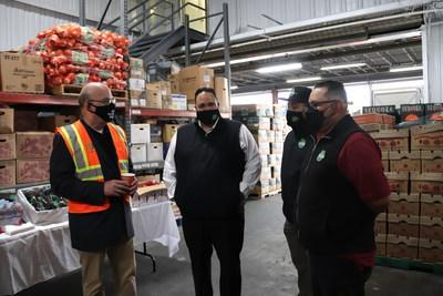 Congressman and Chairman of the House Rules Committee, James McGovern (left), meets with Arcadio's Produce salesperson Jorge Delgadillo and co-owners Manuel Orozco and Luis Orozco inside The SF Market in San Francisco, California. Chairman McGovern is on a national listening tour to learn about successful organizations and community programs that address food insecurity as he pushes for a White House conference on food and nutrition. The SF Market is a wholesale produce market with robust programs.