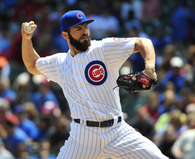 Chicago Cubs starting pitcher Jake Arrieta (49) throws against the St. Louis Cardinals during the first inning in the first baseball game of a doubleheader, Tuesday, July 7, 2015, in Chicago. (AP Photo/David Banks)