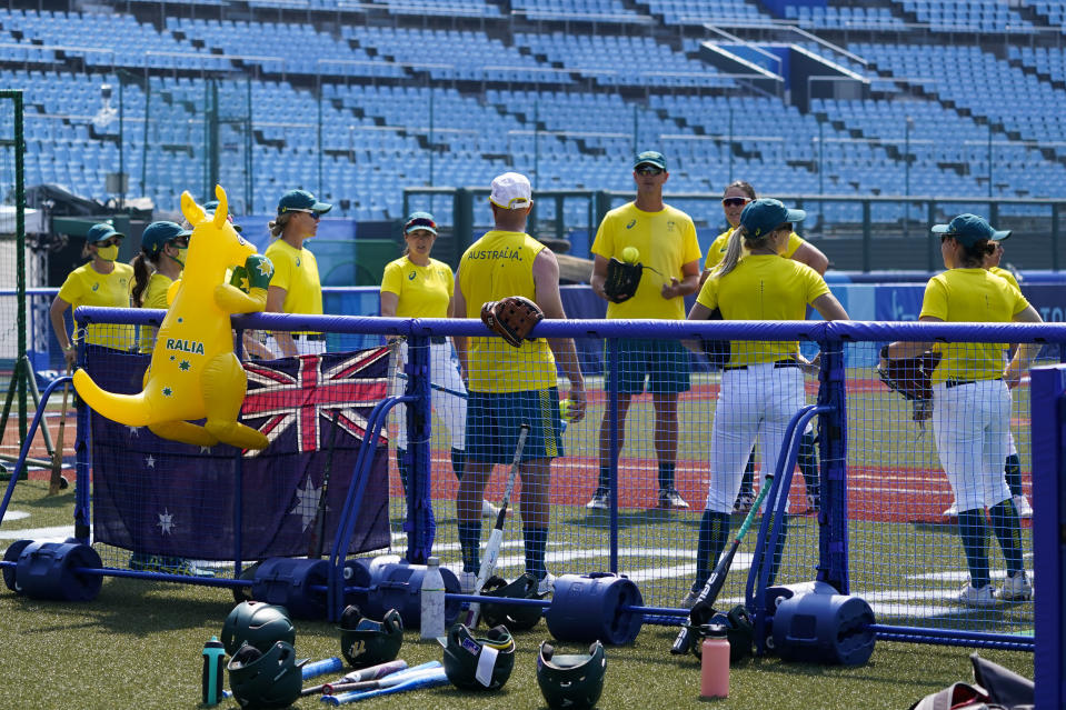 An inflatable boxing kangaroo is placed on a fence as members of the Australian women's softball team gather for a training session at the Azuma Baseball Stadium ahead of the 2020 Summer Olympics, Tuesday, July 20, 2021, in Fukushima, Japan. (AP Photo/Jae C. Hong)