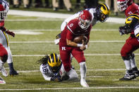 Rutgers' Noah Vedral (0) rushes past Michigan's Luiji Vilain (18) during the first half of an NCAA college football game Saturday, Nov. 21, 2020, in Piscataway, N.J. (AP Photo/Frank Franklin II)