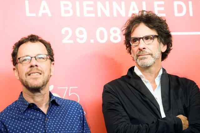 "Director Ethan Coen (L) and his brother director Joel Coen attend a photocall for the film ""The Ballad of Buster Scruggs"" presented in competition on August 31, 2018 during the 75th Venice Film Festival at Venice Lido. (Photo by Filippo MONTEFORTE / AFP) (Photo credit should read FILIPPO MONTEFORTE/AFP via Getty Images)"