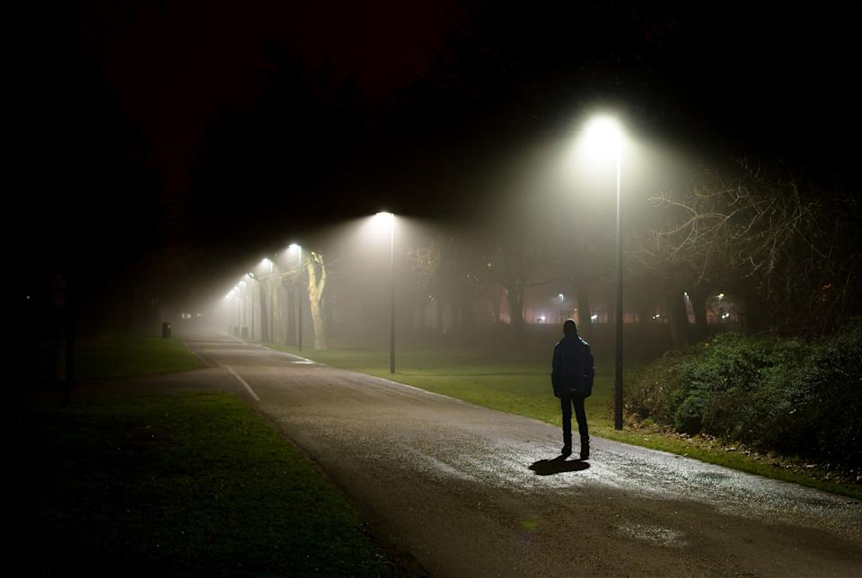 Single Person Walking on Street in the Dark Night (Photo: grafxart8888 via Getty Images)