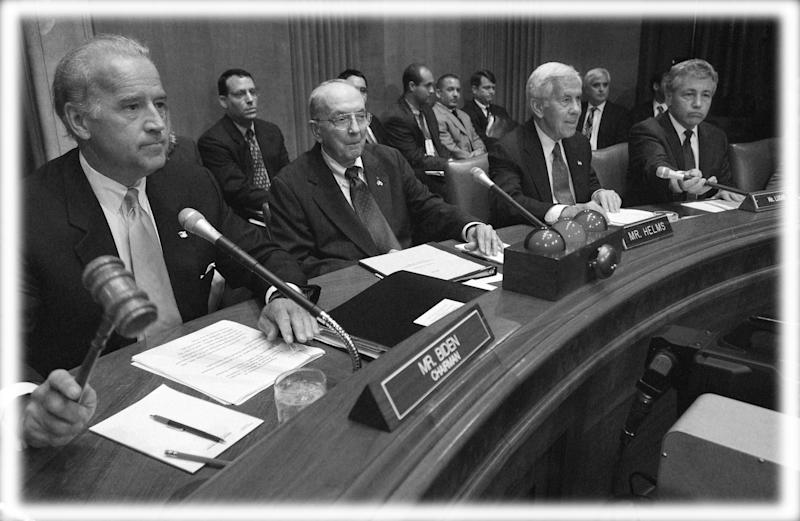Chairman of the Senate Foreign Relations Committee Joe Biden, left, at the start of a hearing regarding Iraq in 2002. (Photo: Scott J. Ferrell/Congressional Quarterly/Getty Images; digitally enhanced by Yahoo News)