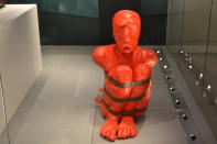 """In this Nov. 24, 2019, photo, a sculpture entitled """"Timalle,"""" by French artist Francois Piquet, which tackles the themes of slavery in the Caribbean, is displayed at the International Slavery Museum in Liverpool, England. The museum seeks to tell the story of the enslavement of people from Africa and how the British city benefited from human bondage. (AP Photo/Russell Contreras)"""