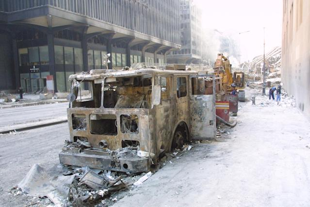 <p>A destroyed fire truck on Sept. 14, 2001, near ground zero after the Sept. 11, 2001, attacks. (Photo: Stuart Ramson/AP) </p>