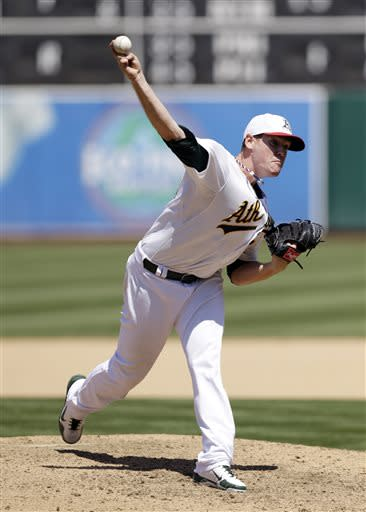 Oakland Athletics starter Dan Straily throws to the Chicago Cubs during the seventh inning of a baseball game Thursday, July 4, 2013, in Oakland, Calif. (AP Photo/Marcio Jose Sanchez)
