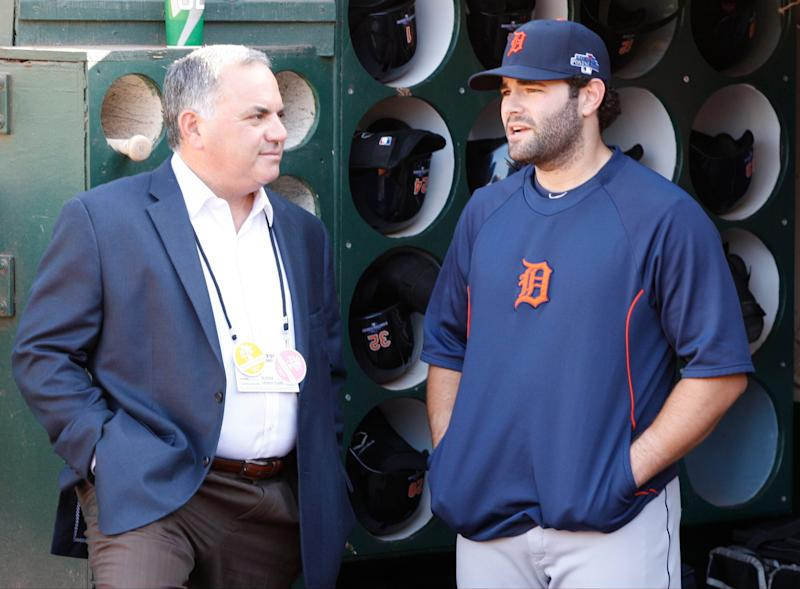 Detroit Tigers Vice President, Assistant GM Al Avila talks with his son Alex Avila in the dugout during batting practice before game 5 of the ALDS against the Oakland Athletics in Detroit on Thursday October 10, 2013.