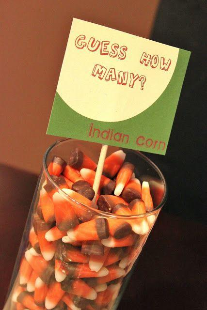 """<p>Place a glass jar or vase filled with candy corn in the center of the kids' table, then let your littlest guests jot down how many candies they think the container holds. The """"winner"""" is whichever child guesses closest to the actual number. This one's sure to foster conversation and keep them entertained throughout the night.</p><p><strong>Get the tutorial at <a href=""""https://celebrationsathomeblog.com/thanksgiving-kids-table-2/"""" rel=""""nofollow noopener"""" target=""""_blank"""" data-ylk=""""slk:Celebrations at Home"""" class=""""link rapid-noclick-resp"""">Celebrations at Home</a>.</strong></p><p><a class=""""link rapid-noclick-resp"""" href=""""https://www.amazon.com/Oh-Nuts-Gourmet-Halloween-Mouthwatering/dp/B07X4ZX5RT/ref=sr_1_2?tag=syn-yahoo-20&ascsubtag=%5Bartid%7C10050.g.4698%5Bsrc%7Cyahoo-us"""" rel=""""nofollow noopener"""" target=""""_blank"""" data-ylk=""""slk:SHOP CANDY CORN"""">SHOP CANDY CORN </a></p>"""
