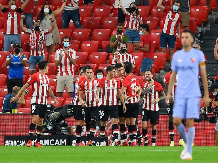 Athletic Bilbao players celebrate after Inigo Martinez put them in front at San Mames