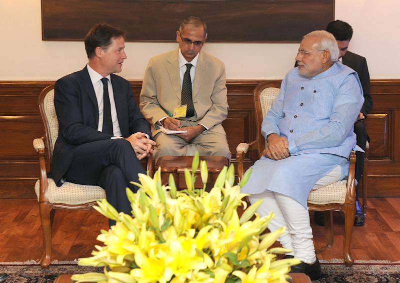 In this photograph released by the Press Information Bureau (PIB) on August 25, 2014, India's Prime Minister Narendra Modi (R) speaks with British Deputy Prime Minister Nick Clegg during a meeting in New Delhi