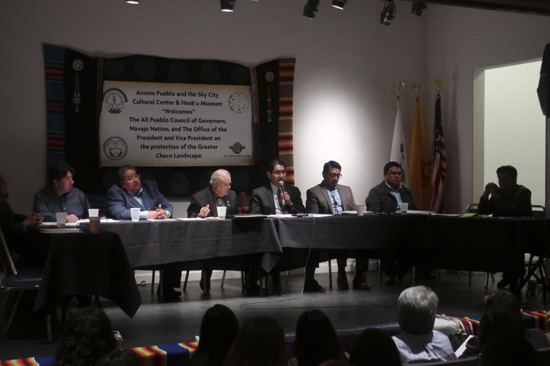 Navajo Nation President Jonathan Nez, center, speaks about protecting sacred and historical sites during a gathering Thursday, March 21, 2019, in Acoma Pueblo, about 60 miles west of Albuquerque, New Mexico. Native American leaders are banding together to pressure U.S. officials to prevent oil and gas exploration around Chaco Culture National Historical Park. (AP Photo/Felicia Fonseca)