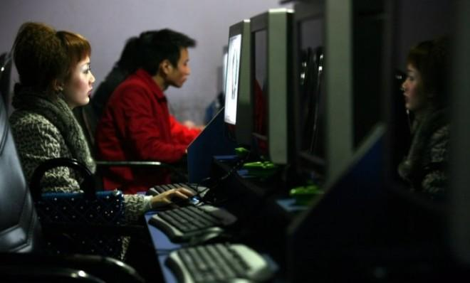 People surf the internet at a cyber cafe in Chongqing Municipality, China.