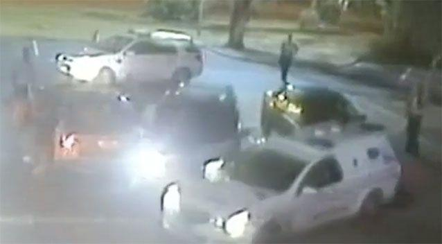 The driver rammed two police cars. Source: 7 News