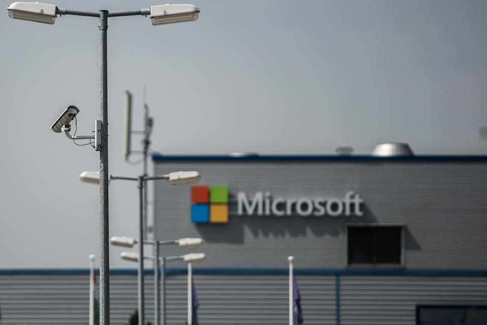 A closed circuit security camera (CCTV) operates on a lamppost at the Nokia Oyj mobile handset factory, operated by Microsoft Corp., in Komarom, Hungary, on Monday, July 21, 2014. Microsoft said it will eliminate as many as 18,000 jobs, the largest round of cuts in its history, as Chief Executive Officer Satya Nadella integrates Nokia Oyj's handset unit and slims down the software maker. Photographer: Akos Stiller/Bloomberg via Getty Images