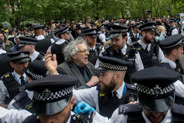Piers Corbyn is led away by police (Picture: Getty)