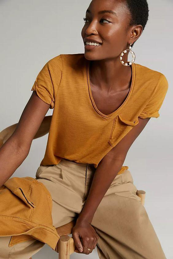 "This weekend-ready mustard tee (complete with pocket) is a must-have for spicing up your basics drawer. $48, Anthropologie. <a href=""https://www.anthropologie.com/shop/classic-v-neck-tee3"" rel=""nofollow noopener"" target=""_blank"" data-ylk=""slk:Get it now!"" class=""link rapid-noclick-resp"">Get it now!</a>"