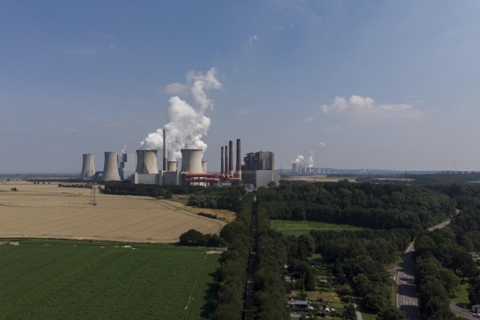 A view of a power plant in the town of Frimmersdorf, Germany, Tuesday, July 20, 2021. Last week's flood disaster has propelled the issue of climate change to the fore of an election campaign that will determine who succeeds Angela Merkel as German chancellor after 16 years in office. (AP Photo/Bram Janssen)